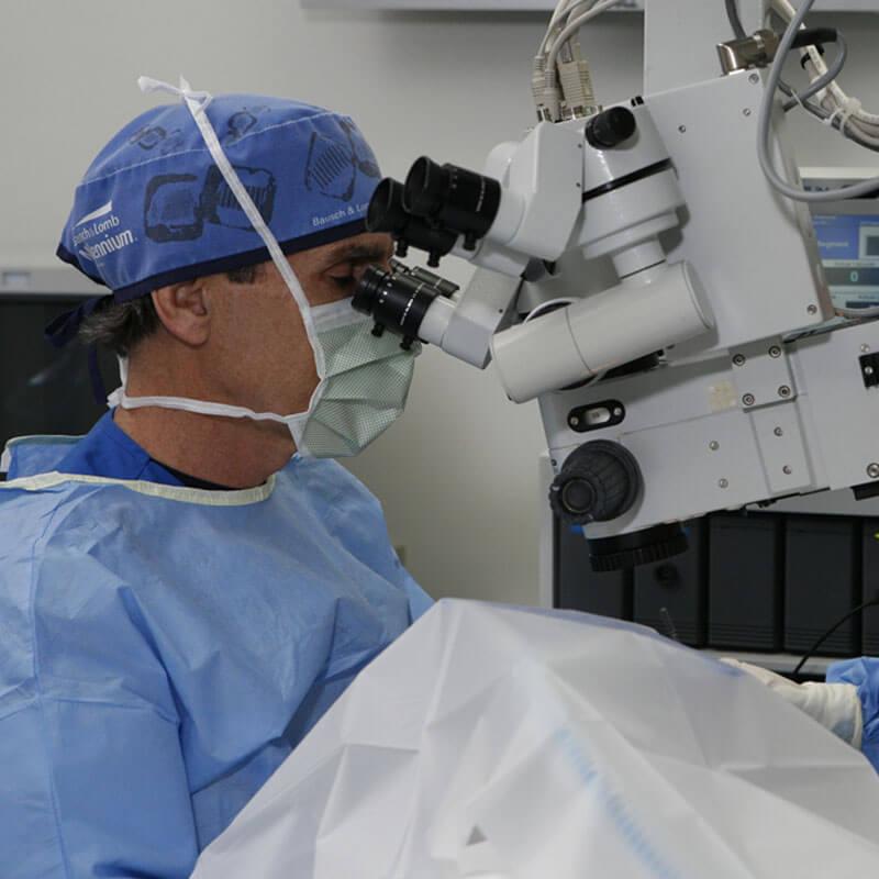 Doctor performing eye surgery