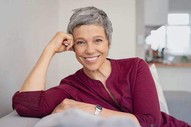 Woman with short gray hair looking at camera