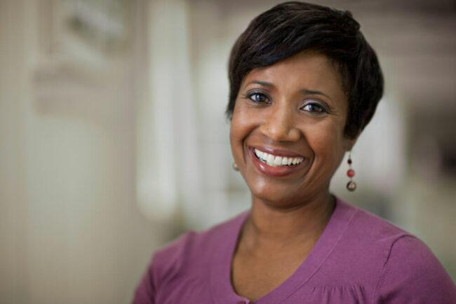 Woman smiling in purple shirt